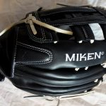 Close up of the Miken Koalition softball glove sitting on tissue paper